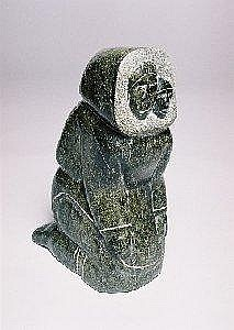 Napachie Ashoona  A large mottled green soapstone carving of an Inuit mother with child sharing her amautik. H 15.5in., 39.4cm.