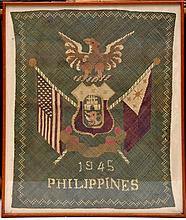 A WWII woven coloured raffia panel to celebrate th