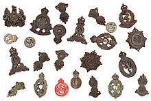16 WWII plastic cap badges, RA grenades, corps, et