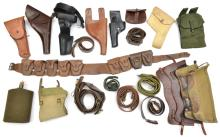 A quantity of holsters, pouches, belts, a bandolier, and similar leather an