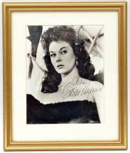 "A head and shoulders studio photographic portrait signed ""Susan Hayward"","