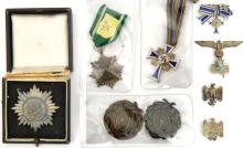 A Third Reich Eastern Peoples award, 1st class with swords in silver, with