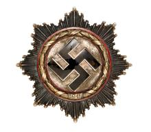 A Third Reich German Cross in gold, with 5 small domed rivets and maker's c