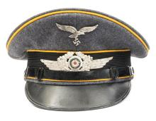 A Third Reich Luftwaffe Flight Section NCOs peaked cap, with metal insignia