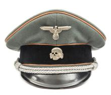 A Third Reich SS officer's peaked cap,  with faded orange piping for Feldge