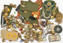 A small quantity of military badges, buttons and insignia, including cap ba