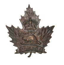 A CEF Eaton's Motor Machine Gun Battery darkened cap badge (50-3-1). VGC Pl