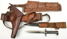 A Sam Browne belt, complete with ammunition pouch and cross strap; also an