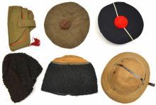 A khaki pith helmet, 2 Eastern European Cossack type astrakhan caps, a mate