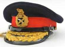 A post 1953 general officer's peaked cap, blue body, red band, gilt bullion