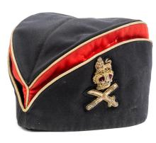A General officer's tent cap, c 1895, of blue and scarlet cloth with gilt p