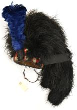 A Highland feather bonnet,  two tails, diced red, white and blue wool headb