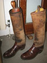 A pair of canvas and leather riding boots, 2 hoof picks, 2 webbing tool bag