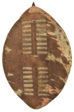 """A small Zulu hide shield,  20"""" overall, with wooden pole and small loop han"""