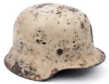 A Third Reich M42 Russian Front combat helmet, with matt white paint over t