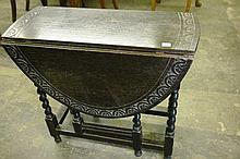 20TH CENTURY EBONIZED CARVED OAK CAROLEON STYLE