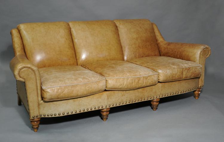three cushion light brown leather sofa on turned legs