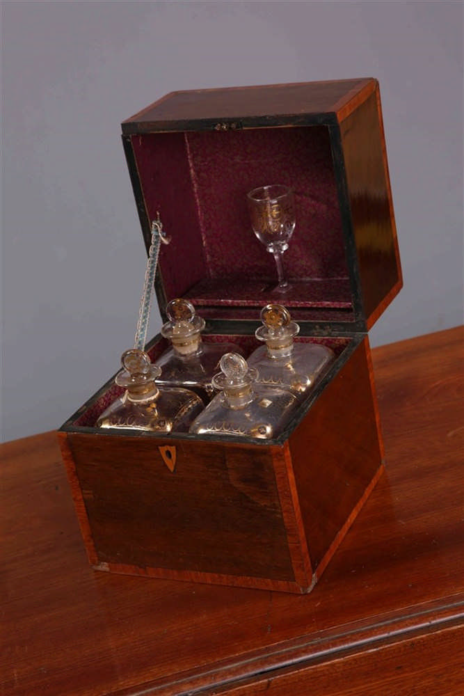 A George Iii Mahogany And Crossbanded Decanter Box Containi