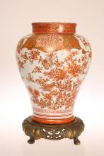 A JAPANESE KUTANI BALUSTER VASE, MEIJI PERIOD, decorated with birds and fol