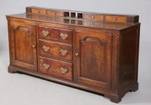 A GEORGE III OAK DRESSER BASE, the moulded rectangular top with spice drawe