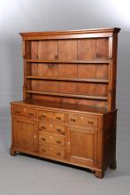 A GEORGE III OAK DRESSER AND RACK, the enclosed rack with moulded cornice,