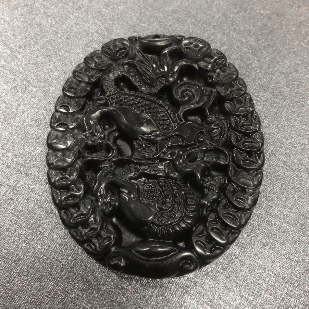 Dark Green Carved Jade Dragon Medallion