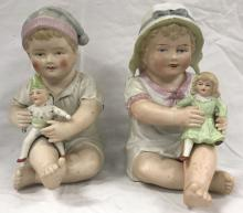 Lot of 2 Porcelain Piano Baby Dolls