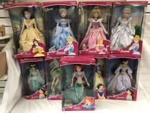 (9) New in Box Disney Porcelain Keepsake Dolls