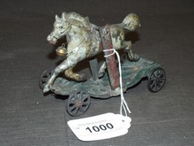 Early American Tin Horse on Platform with Wheels