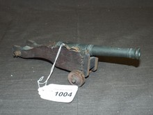 Early Cast Iron Cannon with Wooden Base
