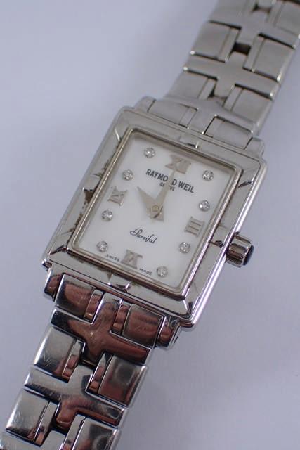 A lady's diamond set Raymond Weil wrist watch