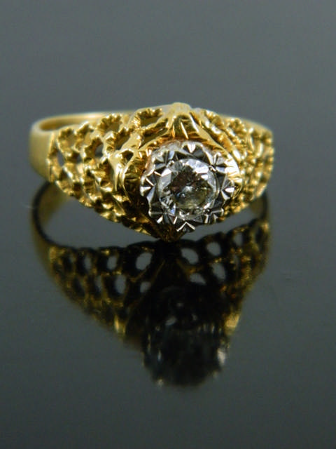 A diamond set ring set in 18ct gold