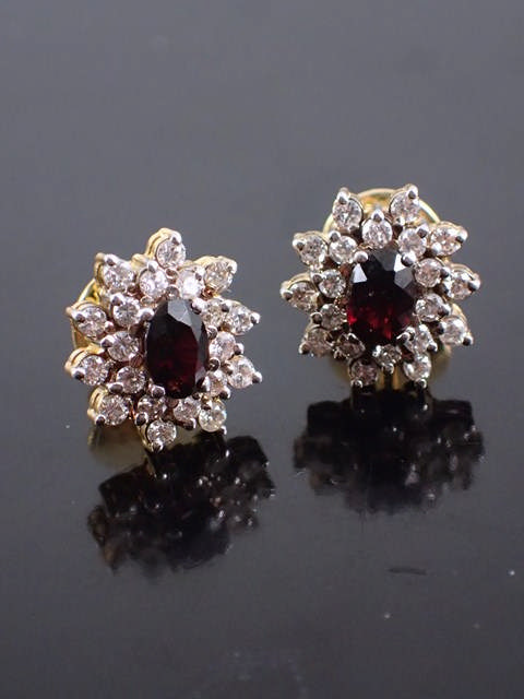 A pair of diamond & gem set cluster gold earrings with a copy of a valuation €2,000 May 2005