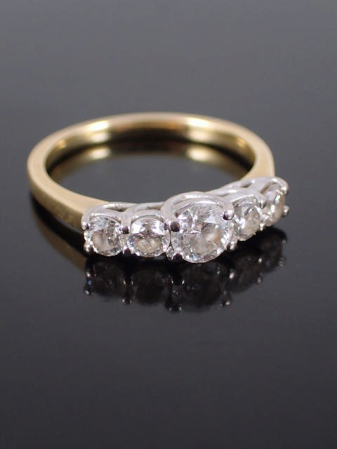 A diamond five stone ring set in 18ct gold