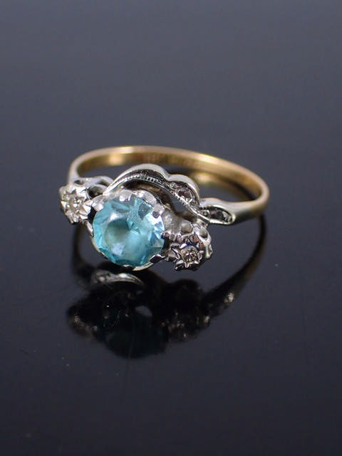 An 18ct gold diamond & gem set ring