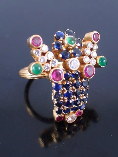 A diamond & gem set ring