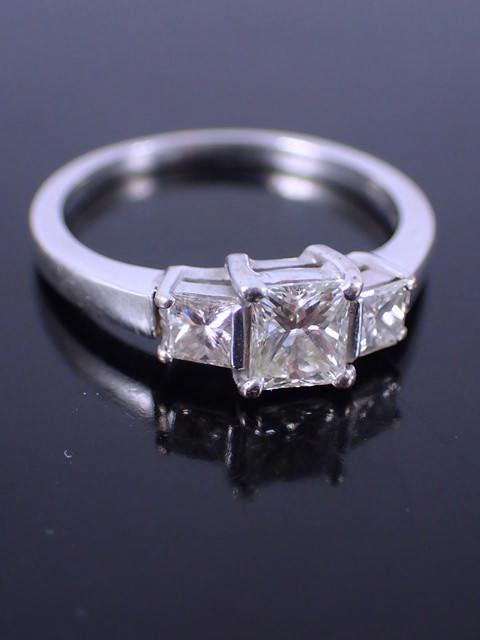 A diamond three stone ring set 18ct gold