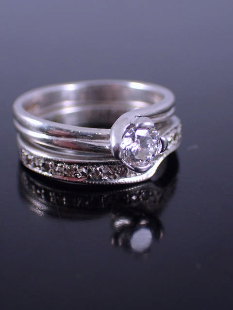 A diamond solitaire ring & a diamond set band ring