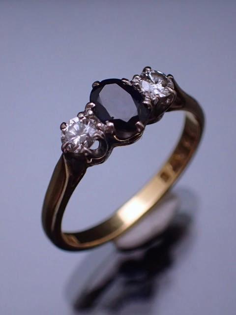 A diamond & sapphire three stone ring