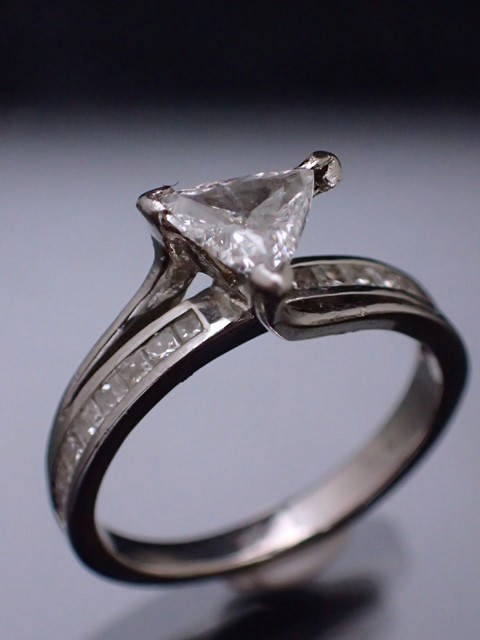 A diamond single stone ring set with diamond shoulders, in platinum