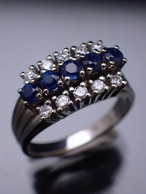 A 14ct gold sapphire & diamond cluster ring
