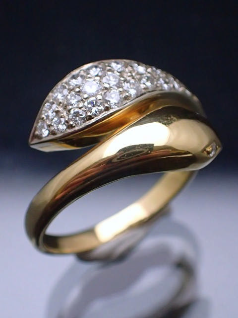 An 18ct gold diamond set snake ring, estimated total weight 0.6cts