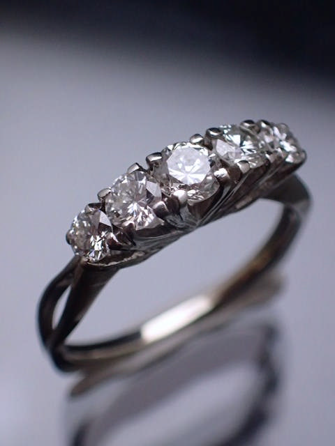 A 14ct gold diamond five stone ring, estimated total weight of diamond 0.75cts