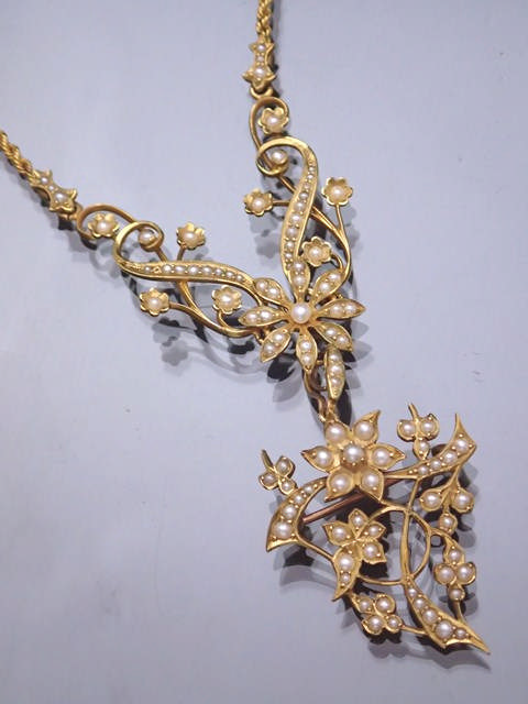 A 15ct gold seed pearl set necklace with detachable drop