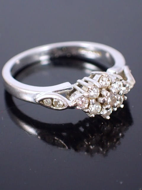 A diamond cluster ring set in 18ct gold with an insurance valuation which states the total weight as