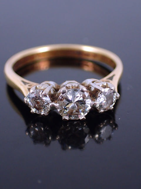 A diamond three stone ring set in 18ct gold