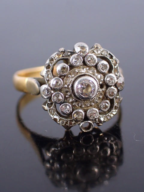 A diamond cluster ring (missing a few stones)
