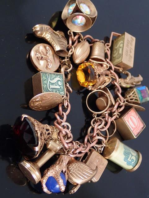 A gold charm bracelet approx. 83 grams