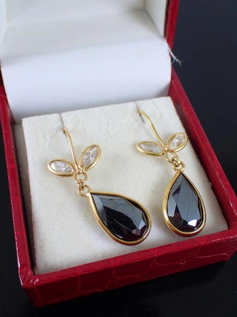 A pair of 18ct gold gem set earrings