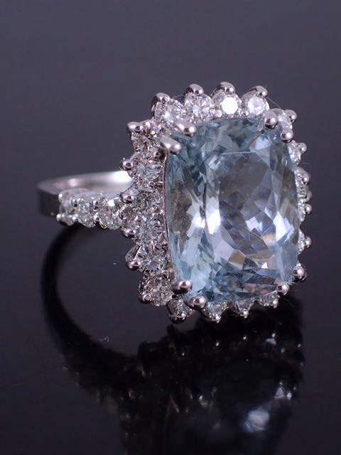 An aquamarine & diamond cluster ring with an appraisal report issued by AIGL which states the aquama